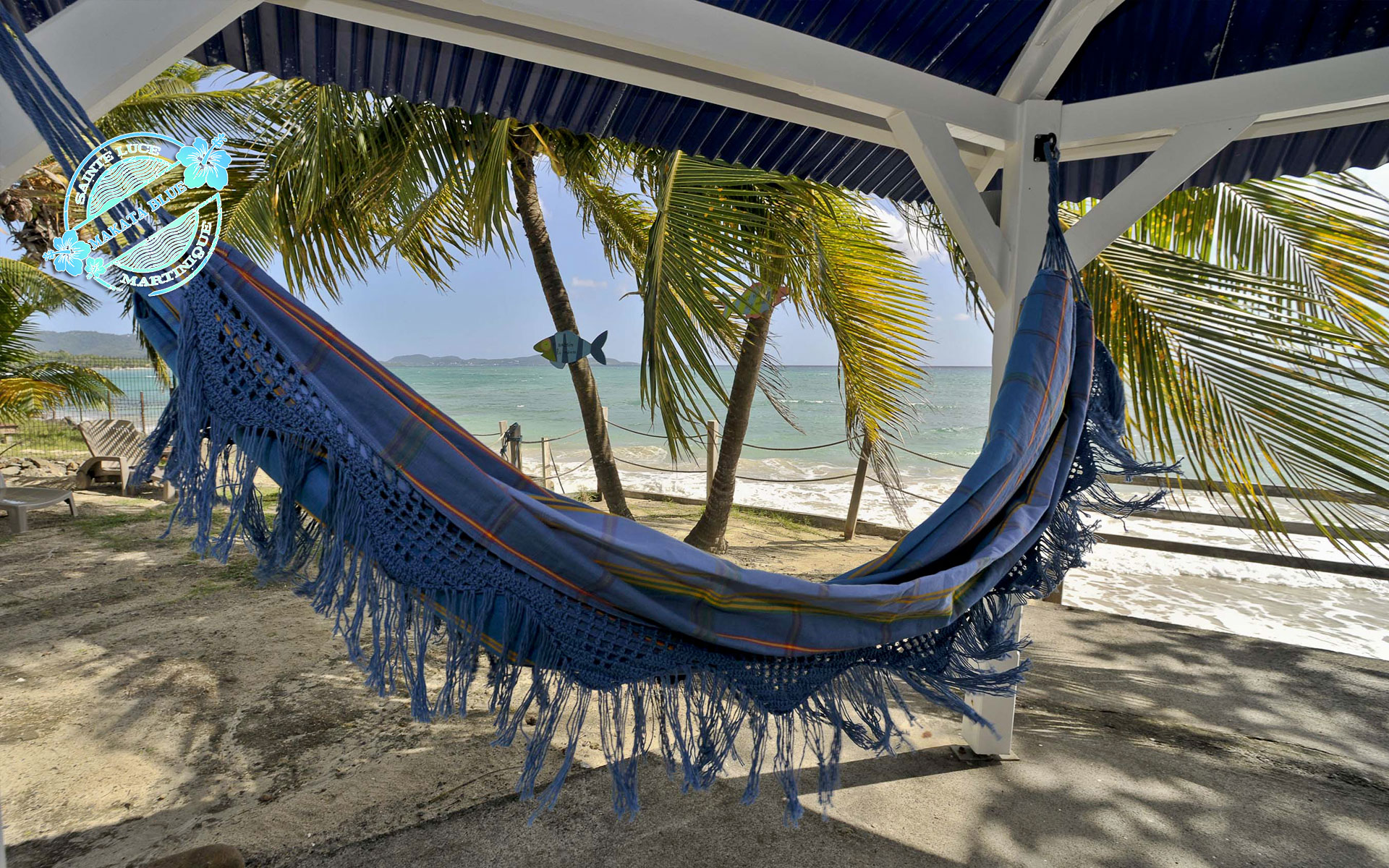 Makata Blue, villa de standing à Sainte Luce, Martinique. Piscine, vue et accès direct sur la plage de la Mer Caraïbe